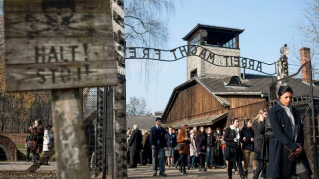 People visiting the memorial site at the former Auschwitz - Birkenau Nazi death camp in Oswiecim, Poland (File picture)