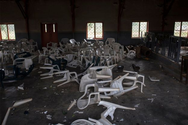 Broken chairs litter the floor of the Catholic church in the village is seen on June 27, 2018, after Fulani herdsman attacked the village.