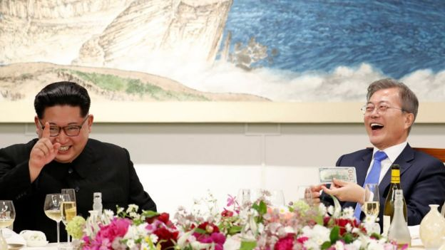 Kim Jong-un, left, and Moon Jae-in laughing together