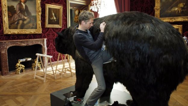 French artist Abraham Poincheval climbs into a fake bear on 31 March 2014 the day before starting an artistic performance in which he will spend 13 days in the bear's skin, at the Hunting and Wildlife Museum in Paris