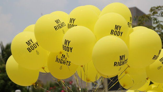 """Amnesty International balloons reading """"My body"""" and """"My rights"""""""