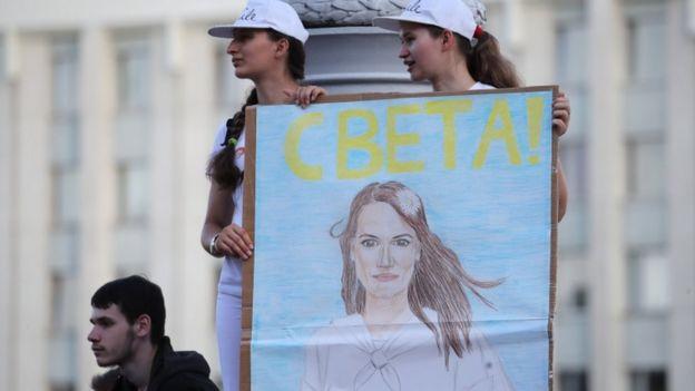 Belarus opposition activists hold a portrait of opposition leader Svetlana Tikhanovskaya during a rally in Minsk, Belarus, 17 August 2020