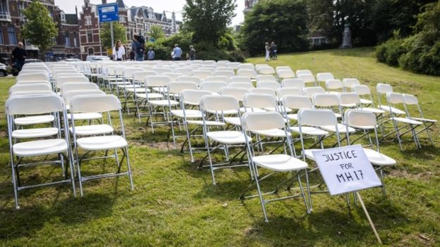 White chairs and a placard are set up by relatives of crash victims of flight MH17 as a silent protest in front of the Russian embassy in The Hague in the Netherlands, 8 May 2018