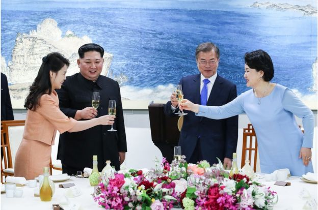 "North Korea""s leader Kim Jong Un (2nd L) and his wife Ri Sol Ju (L) toast with South Korea""s President Moon Jae-in (2nd R) and his wife Kim Jung-sook (R) during the official dinner at the end of their historic summit at the truce village of Panmunjom on April 27, 2018. The leaders of the two Koreas held a landmark summit on April 27 after a highly symbolic handshake over the Military Demarcation Line that divides their countries, with the North""s Kim Jong Un declaring they were at the ""threshold of a new history"". / AFP PHOTO / Korea Summit Press Pool / Korea Summit Press PoolKOREA SUMMIT PRESS POOL/AFP/Getty Images"