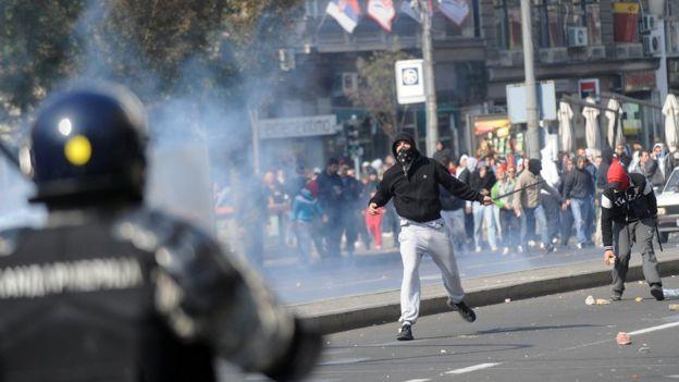 Anti-gay protestors surrounded by police at Belgrade's pride, Belgrade, Serbia 2014.