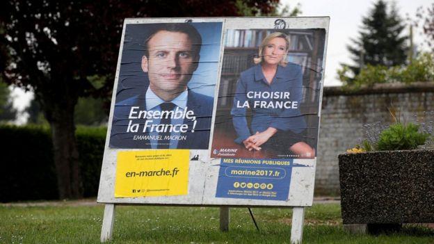 马琳·勒庞(左)与马克龙(右)在北部城市索尔吕的竞选海报(5/5/2017)