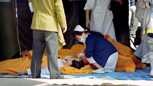 Victims of the 1995 attack being treated by a nurse