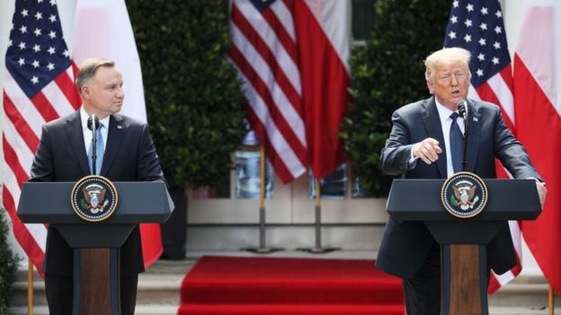Donald J. Trump (R) and Polish President Andrzej Duda (L) hold a joint press conference in the Rose Garden of the White House in Washington, DC