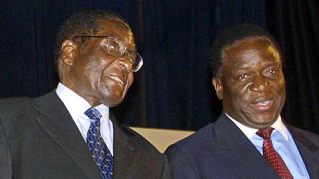 Zimbabwe's President Robert Mugabe (L) talks to Emmerson Mnangagwa, one of the two candidates running for the post of vice president 03 December 2004 at the Zanu-PF National People's Congress.
