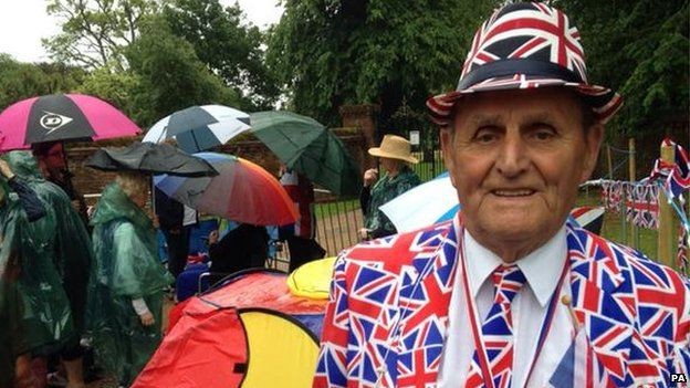 Terry Hutt, royal watcher, waits to see the Duke and Duchess arrive for the christening
