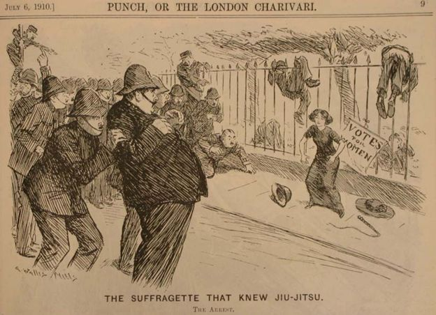 "Punch cartoon: ""The suffragette that knew Jiu-Jitsu"" - policemen cower in front of suffragette"
