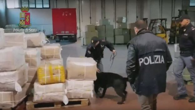 Screen grab of video shows Italian police inside a depot