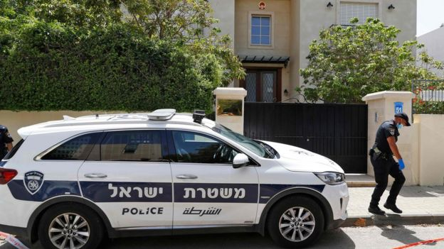 A police car outside the Chinese ambassador's residence near Tel Aviv, 17 May