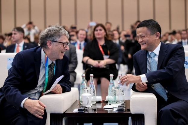 Microsoft founder Bill Gates (L) talks with Alibaba Chairman Jack Ma (R) bfore duirng the Hongqiao International Economic and Trade Forum in the China International Import Expo at the National Exhibition and Convention Centre on November 5, 2018 in Shanghai, China. The first China International Import Expo will be held on November 5-10 in Shanghai. (Photo by Lintao Zhang/Getty Images) Import Expo Paraallel Session on Trade Innovation