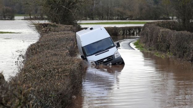 A van sits in floodwater near the village of Hampton Bishop near Hereford, after the River Lugg burst its banks in the aftermath of Storm Dennis