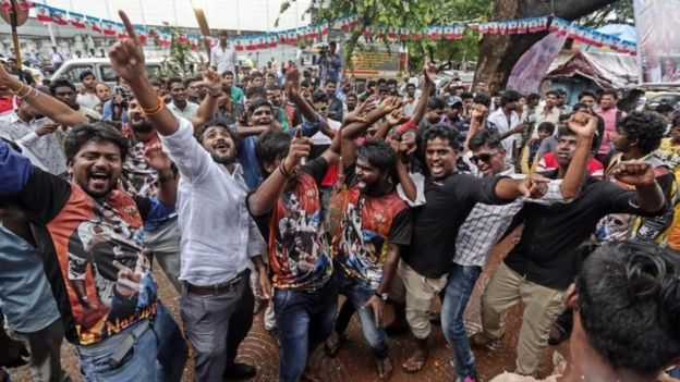 "Indian fans of superstar Rajinikanth dances as they celebrates his much awaited film ""Kabali"" at Aurora theatre in Mumbai, India, 22 July 2016"