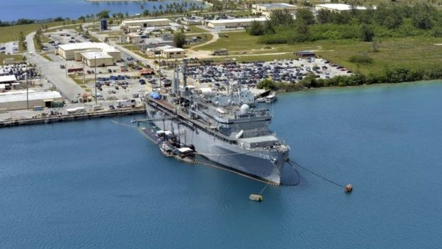 This image obtained from the US Department of Defense shows the submarine tender USS Emory S. Land and the Los Angeles-class attack submarine USS Topeka pierside in their home port at Polaris Point, Guam, on April 19, 2017.
