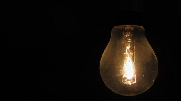 A lit bulb in a dark room