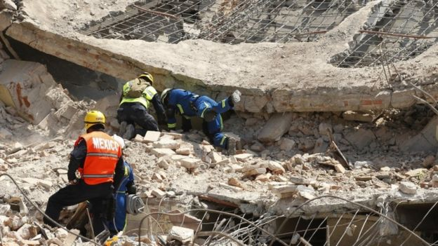 Rescuers and army workers search in rubble in Juchitan