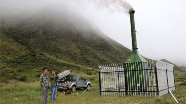 Hillside of a mountain in Chinese Tibet with a combustion chamber.