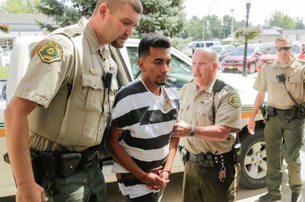 The suspect entering court