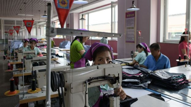 This photo taken on June 12, 2018 shows an employee of the Ryo Won Footwear Factory operating a sewing machine in Pyongyang. US President Donald Trump dangled the carrot of foreign investment in front of North Korean leader Kim Jong Un at their nuclear summit, but analysts say few will want to put money into one of the highest-risk business environments in the world.