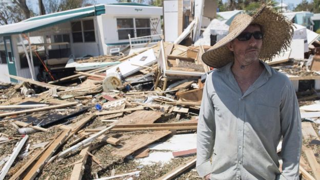 Resident Bill Quinn surveys the damage to his home in the wake of Hurricane Irma at the Seabreeze Trailer Park in Islamorada in the Florida Keys, 12 September 2017