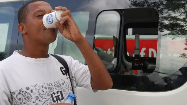 Jed Lesperance taking his methadone at a mobile clinic in Seychelles
