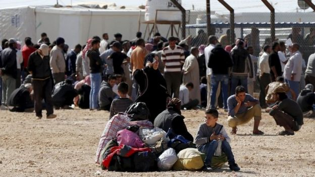 Syrians refugees wait to register their names to go back to their homeland at Al Zaatari refugee camp in the Jordanian city of Mafraq, near the border with Syria