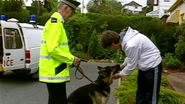 Jim McNichol meeting Bryn the police dog