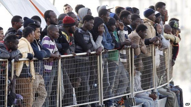 Migrants wait to disembark from a vessel in Sicily, southern Italy. Photo: May 2015