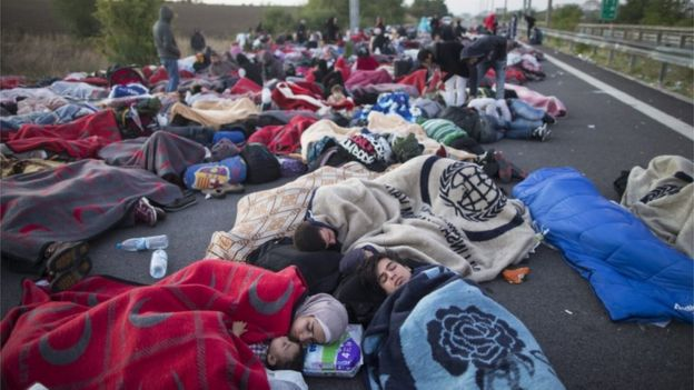 Syrian refugees sleep at the Istanbul-Edirne highway as they wait for permission to cross the Turkish Greek border to reach Germany, in Edirne, Turkey, on 19 September 2015.