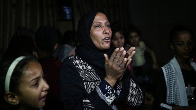 Palestinian relatives mourn during the funeral of eight-month-old Layila al-Ghandour,