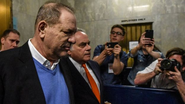 Harvey Weinstein exits the court room with his lawyer Benjamin Brafman after his arraignment at Manhattan Criminal Court on May 25, 2018