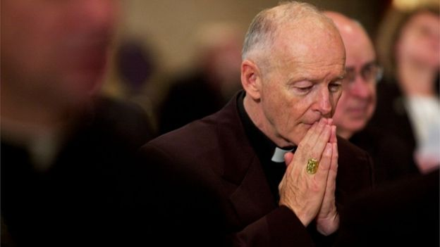 Archbishop of Washington Cardinal Theodore McCarrick praying