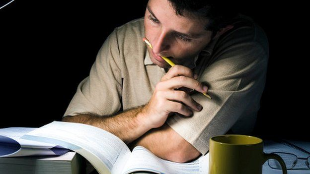 A university student studying for an exam