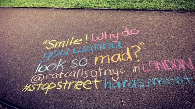"A catcall reading ""Smile why do you want to look so mad?"" written in chalk on the ground"