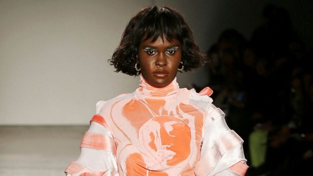 Ms Lefevre on a runway, not wearing the accessories worn by the other models