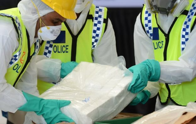 Sri Lankan police personnel prepare seized cocaine to be destroyed under judicial supervision in Katunayake on January 15, 2018. Around a tonne of the narcotics has been seized over the past year while in transit via Colombo