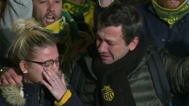 Nantes fans crying at a vigil for Emiliano Sala