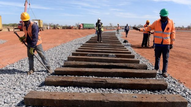 Construction workers building a railway