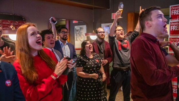 Liberal supporters cheer as election results begin to come in