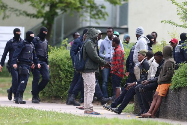 Picture of police intervening at a refugee centre