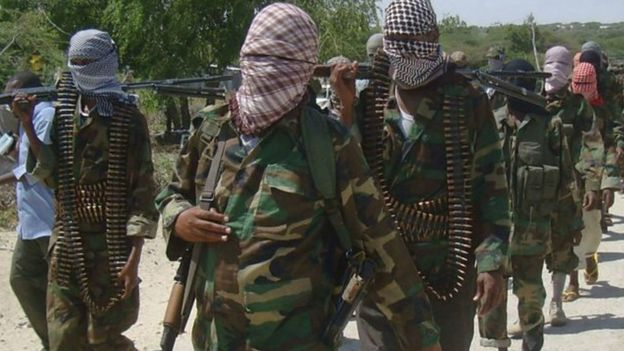 Masked and armed al-Shabab fighters.