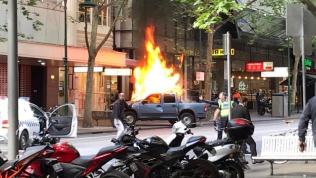 A car on fire at Bourke street