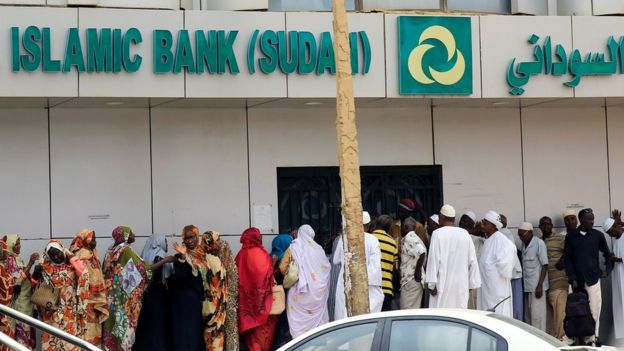 Sudanese customers queue to access money services at the Faisal Islamic Bank (Sudan) in Khartoum, Sudan June 11, 2019.