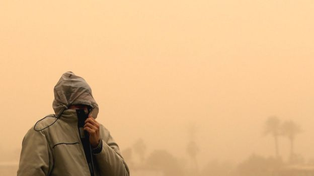 A man covers his face during a sandstorm in Cairo, Egypt, 16 January 2019