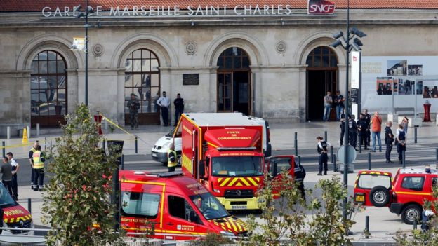 Emergency services vehicles are seen outside the Saint Charles train station (1 October)