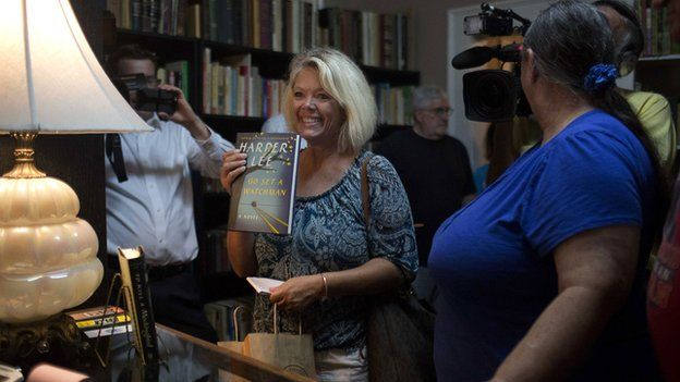 Book fan Julia Stroud was the first in line to get a copy of Go Set A Watchman during the midnight book release in the hometown of author Harper Lee