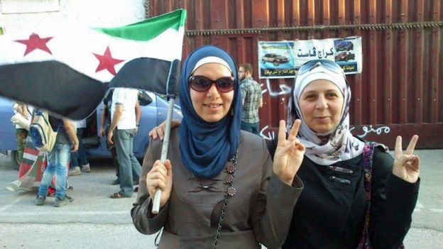 Oum on the right at a rally in East Aleppo